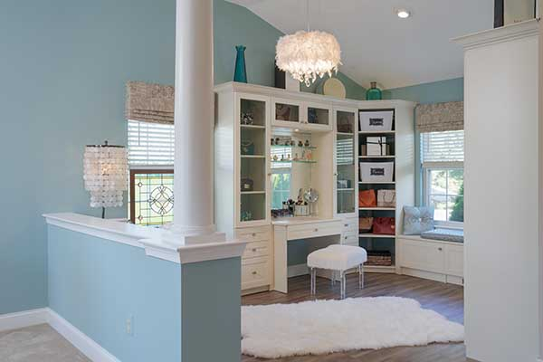 Creative walk-in closet design with sitting room area