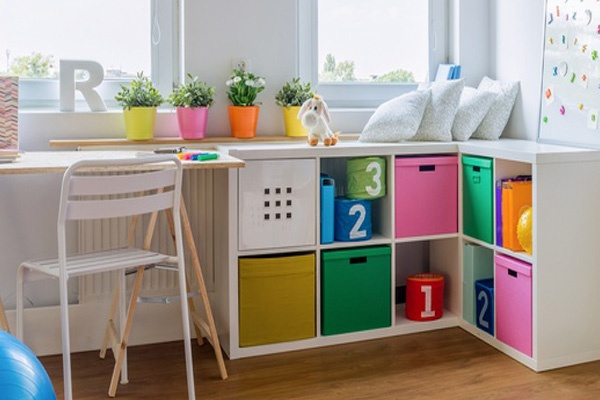 Cozy colorful play room for child neat and organized